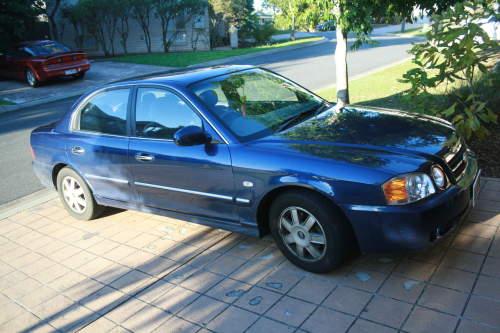 2004 used kia optima sedan car sales eight mile plains qld for Motor mile auto sales